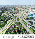 Aerial city view with crossroads and roads, houses, buildings, parks and parking lots. Sunny summer 41382503