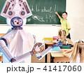 Teacher robot with school children in school class near blackboard. 41417060