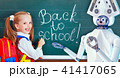Teacher robot with schoolchild girl in school class near blackboard. 41417065