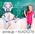 School child and ai android robot writting on blackboard in classroom. 41425270