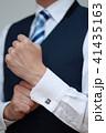 カフスボタン (ボディパーツ 顔なし 人物 会社員 ワイシャツ 役職 社長 コピースペース 手) 41435163