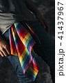 man with a rainbow-patterned handkerchief 41437967