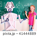 School child and ai robot writting on blackboard in classroom. 41444889