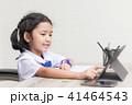 Asian little girl in student uniform doing homewor 41464543