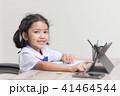 Asian little girl in student uniform doing homewor 41464544