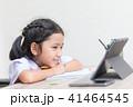 Asian little girl in student uniform doing homewor 41464545