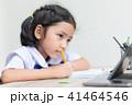 Asian little girl in student uniform doing homewor 41464546