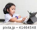 Asian little girl in student uniform doing homewor 41464548