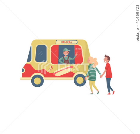 Young couple near hot-dog truck. Cheerful seller waving by hand. Van with traditional street fast 41469723