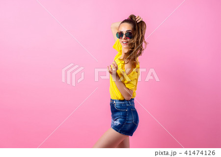 Happy teenage girl standing with flying hair 41474126