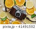 Vintage Camera Between Fresh Orange Lemon 41491502