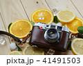Vintage Camera Between Fresh Orange Lemon 41491503