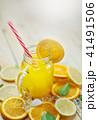 Glass of Orange Juice Leaves Citrus Ice Sea Shells 41491506