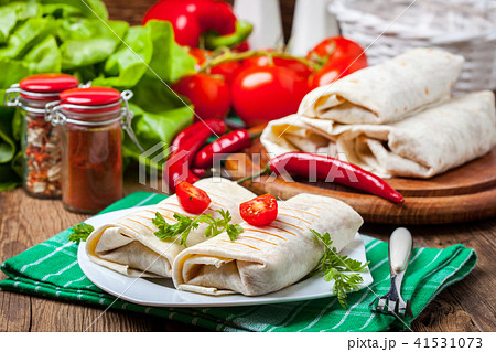 Burritos filled wiht minced meat 41531073