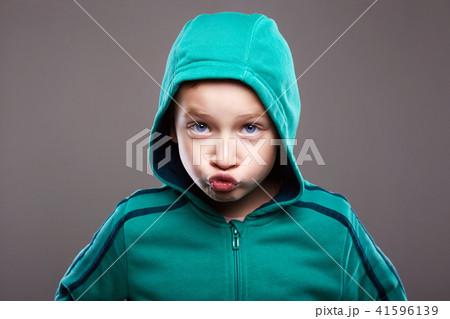 child boy.funny grimace emotion kid 41596139