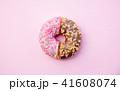 Two parts of donuts, pink and chocolate 41608074