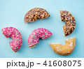 Sweet cut donuts on pink background isolated 41608075