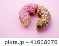 Two parts of donuts, pink and chocolate 41608076