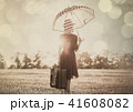 young woman with umbrella and suitcase 41608082