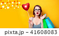 Woman with shopping bags and heart 41608083