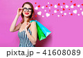 Woman with colour shopping bags 41608089