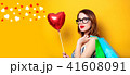 Woman with shopping bags and heart 41608091