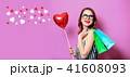 Woman with shopping bags and heart 41608093
