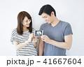 夫婦 白バック 妊娠の写真 41667604