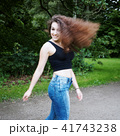 playful young woman swinging her hair 41743238