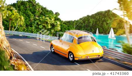 Cute little retro car goes by the road  41743360