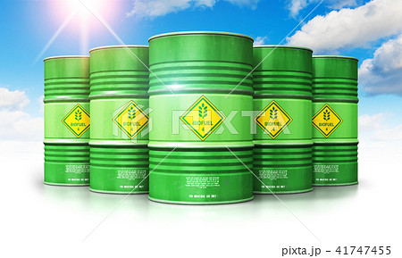 Biofuel drums against blue sky with clouds sun 41747455