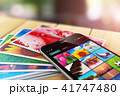 Stack of photos smartphone with image gallery app 41747480