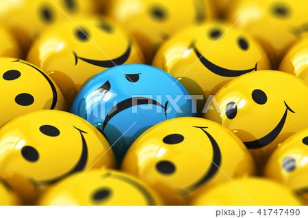 Single sad blue smiley among happy yellow ones 41747490