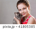 Cute smiling little girl holds funny gray chinchilla. 41805385