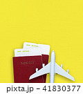 Passports, boarding passes and toy airplane 41830377