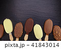 Ice cream on stick covered with chocolate 41843014