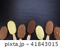 Ice cream on stick covered with chocolate on black 41843015