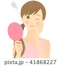 手鏡を見てニキビを気にする女性 02 41868227