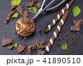 Chocolate ice cream in scoop on black slate 41890510