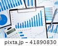 金融や会計のレポート。データの分析と収集のイメージ。青いグラフと電卓。 41890830
