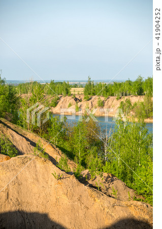 Photo of picturesque hilly area with vegetation and blue lake 41904252