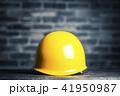 レンガ背景と黄色いヘルメット 41950987