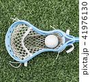 Carolina blue lacrosse stick with a ball 41976130