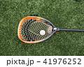 Orange goalie stick with a ball 41976252