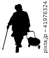 Silhouette of an elderly woman with a cane 41976324