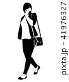 Silhouette of a walking woman with phone 41976327