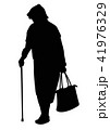 Silhouette of an elderly woman with a cane 41976329