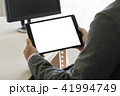 Digital tablet computer close up man using tablet  41994749