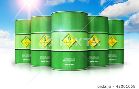 Green biofuel drums against blue sky with clouds 42001059
