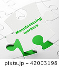 Industry concept: Manufacturing Workers on puzzle background 42003198